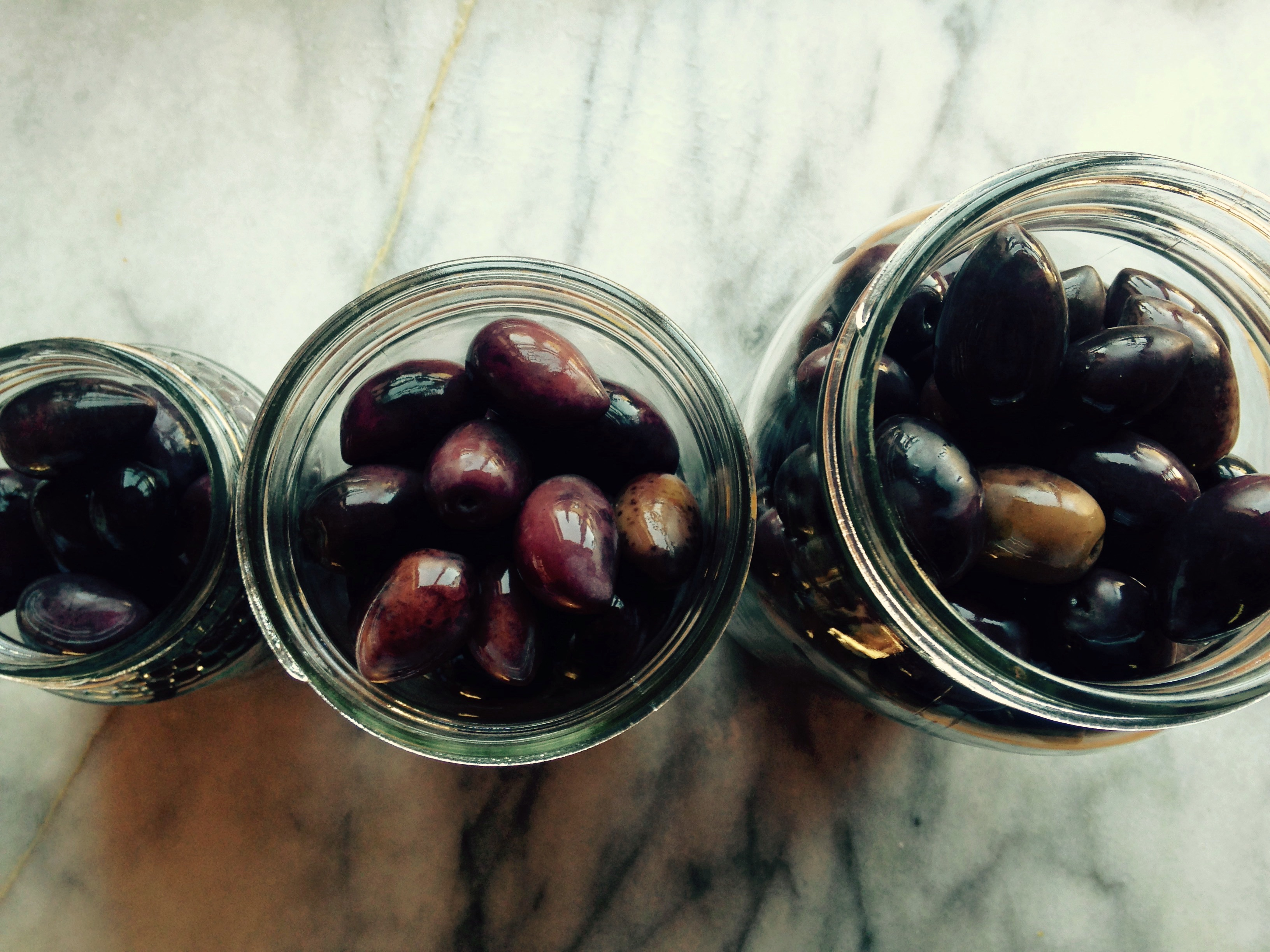 Pickled Kalamata olives in jars